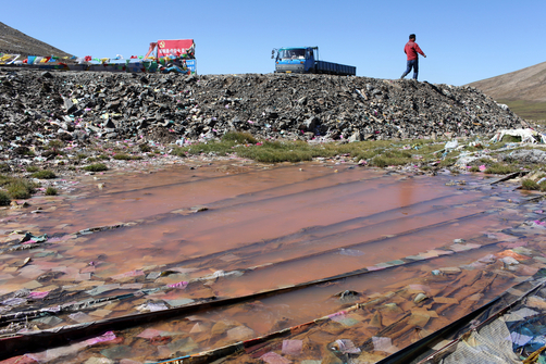 A contaminated pool of water by the side of one of the major highways that runs through the northeastern region of the Tibetan Plateau.