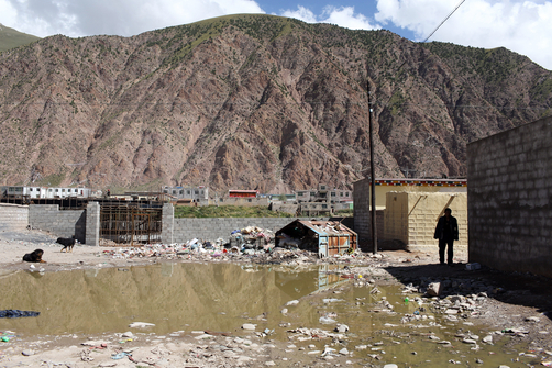 A Tibetan man walks through a relocation town in Zaduo, in the far interior of the Tibetan Plateau.