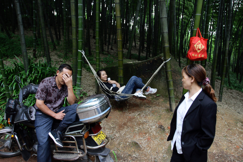 Locals relax amongst the forests of the Bamboo Sea.