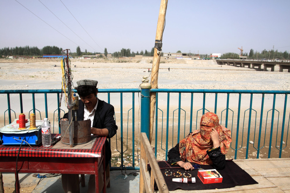 A small market next to a dried-up river in Xinjiang Province, western China.