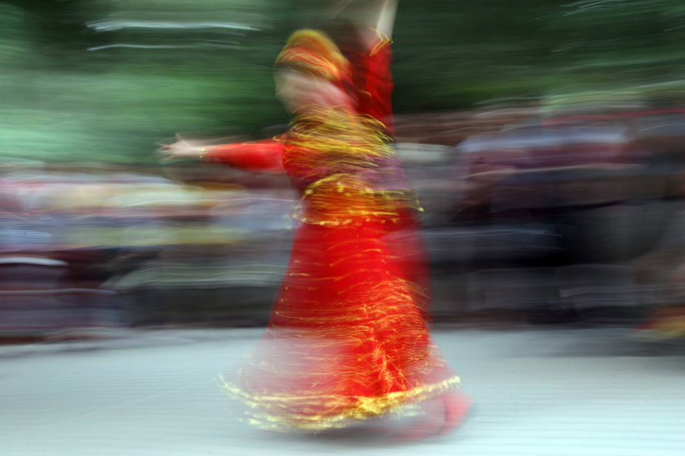 A woman dancing in Jinshan Park, located north of the Forbidden City.