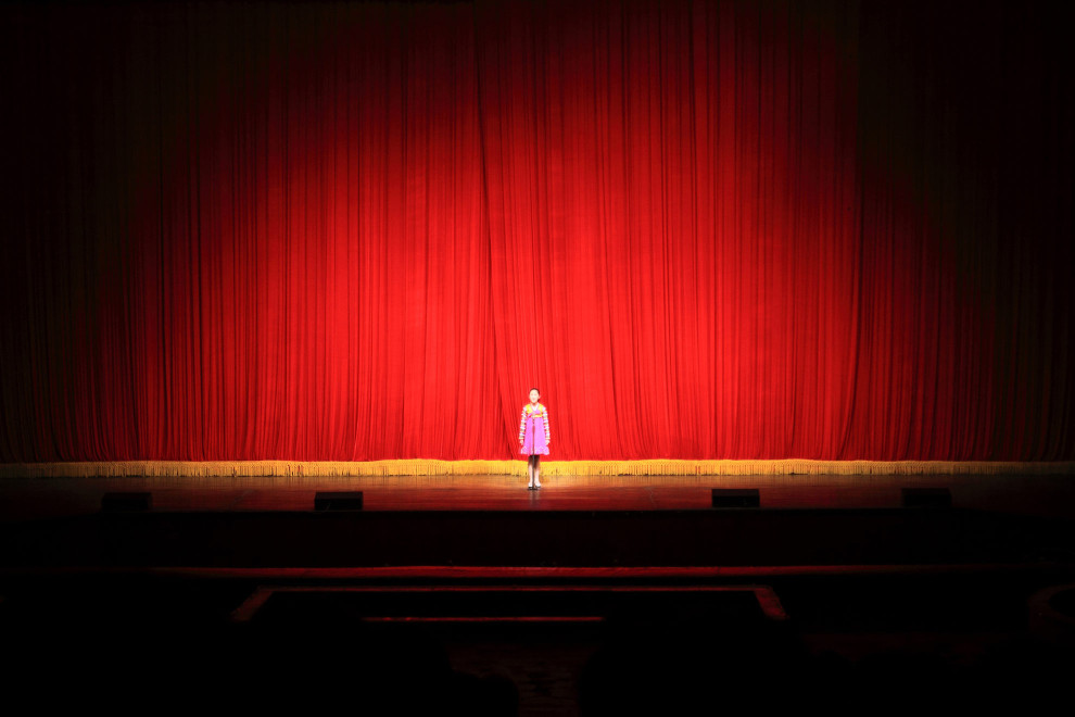 A North Korean girl stands on stage in the Mangyongdae Children's Palace, an opulent after-school center for the children of North Korea's elite in Pyongyang.