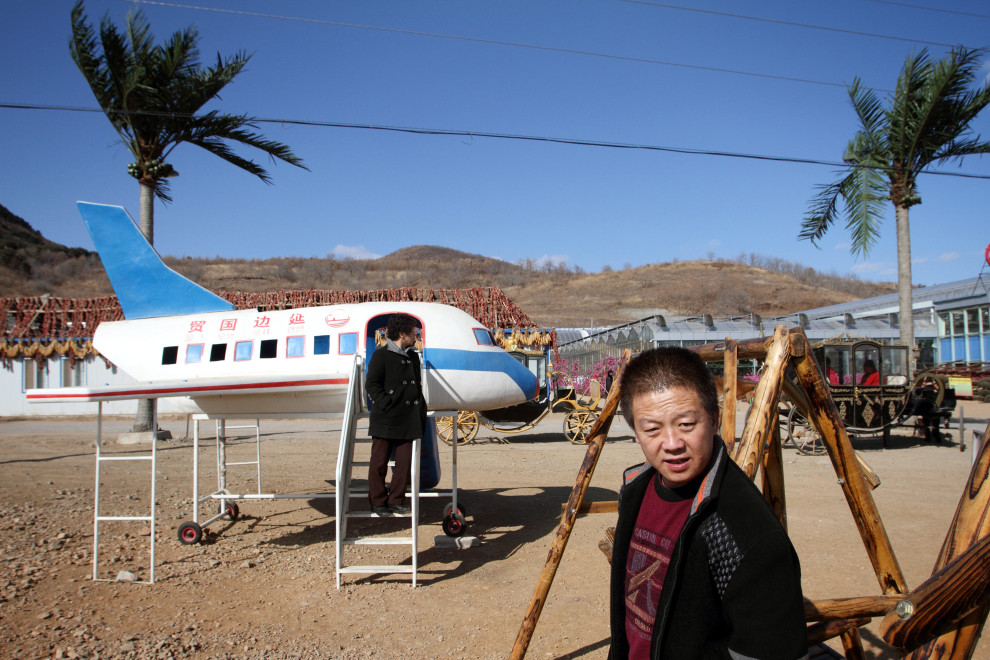 Visitors outside an agricultural shopping centre in the town of Yanji, close to the border with North Korea.