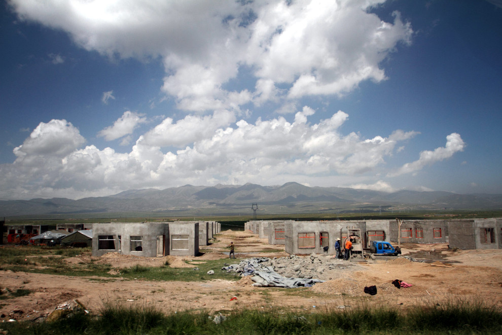 A nomad resettlement village under construction near Qinghai Lake. It is estimated that up to 100,000 nomads have been removed from the grasslands and forced to move into these newly built towns and villages.