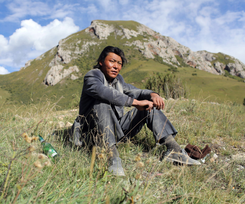 A Tibetan man on the highland grasslands in the Amdo region of the Tibetan Plateau.
