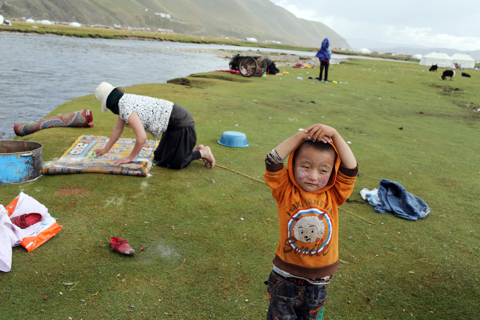 A young boy stands near the banks of a small river running through the town of Sershul, in northern Sichuan Province on the Tibetan Plateau. The region is known as Sanjiangyuan, or Three Rivers Headwaters, as it is the source of the Yangtze, Mekong and Yellow Rivers which feed millions of people who live downstream.