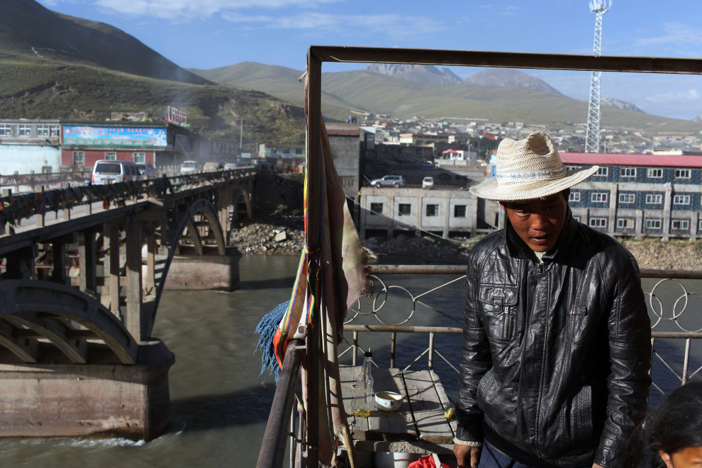 A Tibetan man near one of the first bridges that crosses the Mekong River, in the town of Zaduo on the Tibetan Plateau. The Mekong River quickly leaves China after originating on the plateau. However, China's management of this important resource will have implications for its future relationships with its neighbors who rely on water from this river.