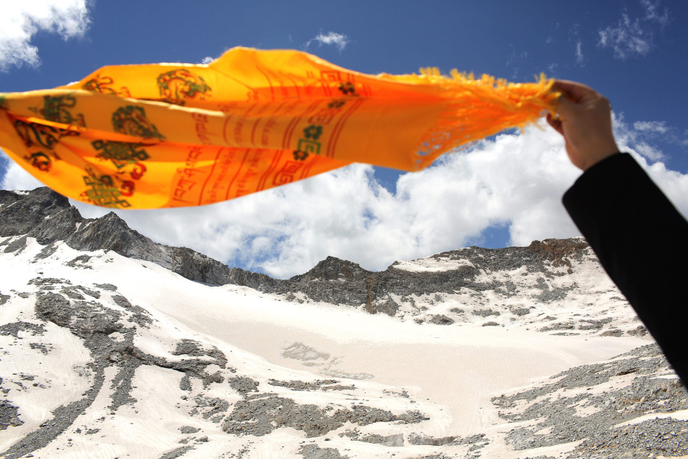 A Tibetan flag flies over the Dagu Glacier. The glacier has been shrinking in recent years, as a result of rising temperatures in the region.