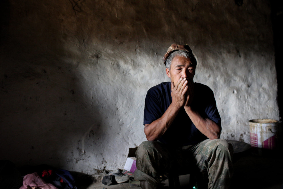 A Tibetan man in a village in the region of Aba.