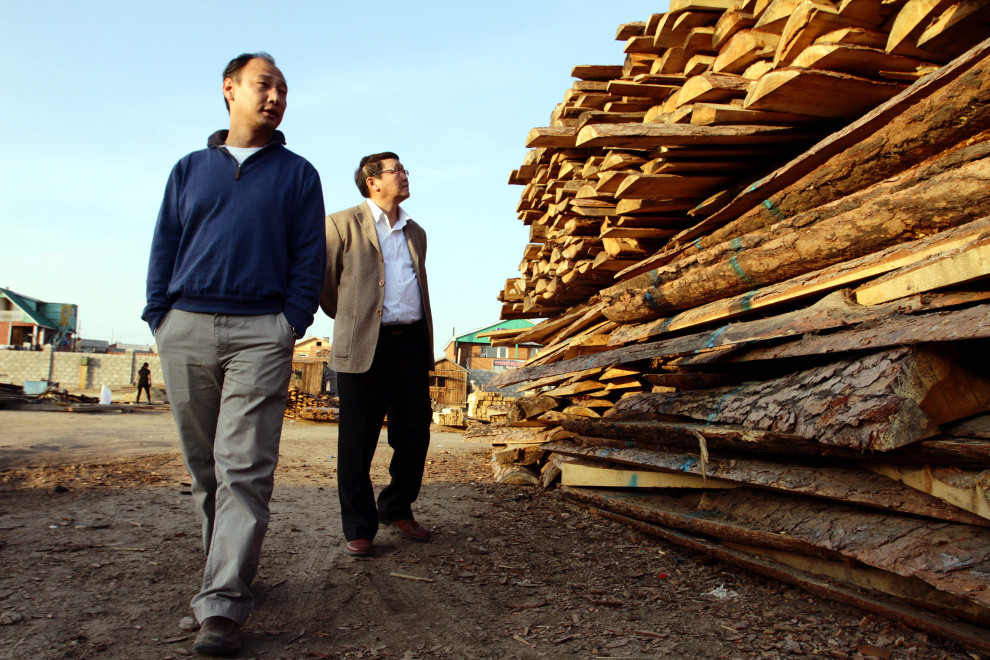 Dashzeveg Tserendeleg (left), National Project Coordinator and Ganbold (right) FAO Field Facilitator in a timber yard in the town of Darkhan.