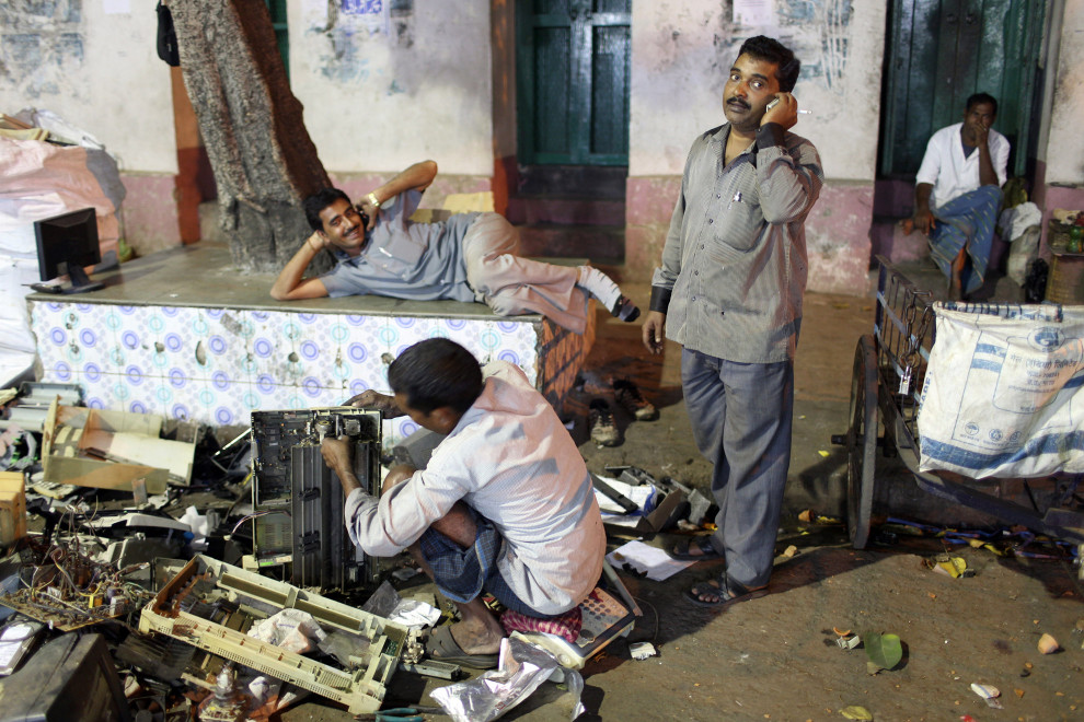 Second hand electronic waste dealers begin the breakdown process in the Chandi Chowk area in central Kolkata.