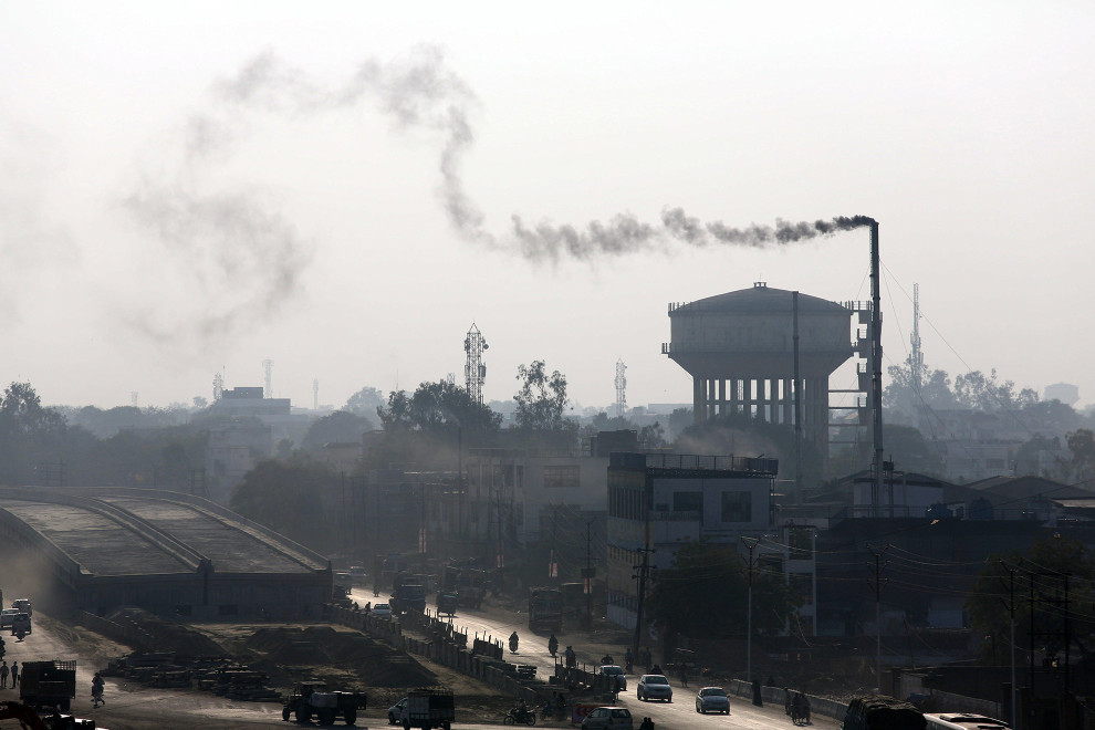 A smoke stack above a tannery belches out toxic air pollution above the Jajmau area of Kanpur.