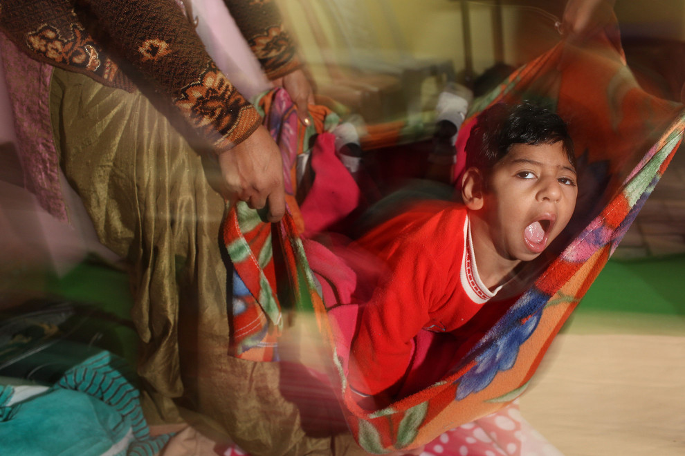A young child during a play session at the Baba Farid Center for Special Children in Faridkot, Punjab.