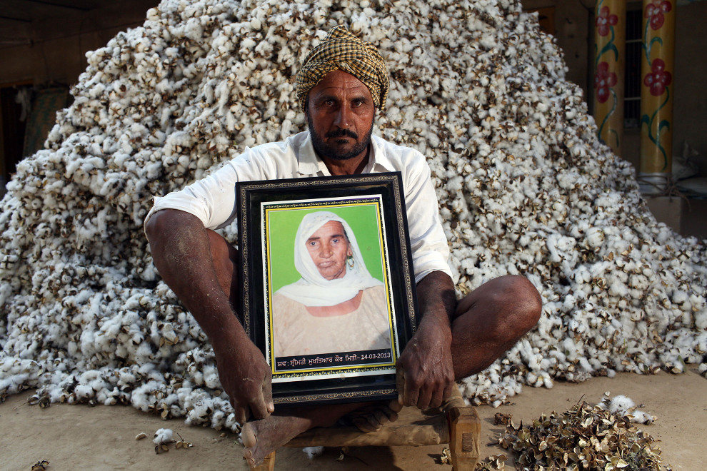 Balkaur Singh (52) holds a portrait of his late mother Mukhtyar Kaur, who died in 2013 of breast and liver cancer, aged 75. It is believed that excessive pesticide use in the region over the past 30-40 years has led to the accumulation of dangerous levels of toxins such as uranium, lead and mercury which are contributing to increased health problems including cancers, birth defects and mental disabilities in children. It's a hidden epidemic which is gripping the Punjab region in northeast India which for decades has been the country's 'bread basket'.