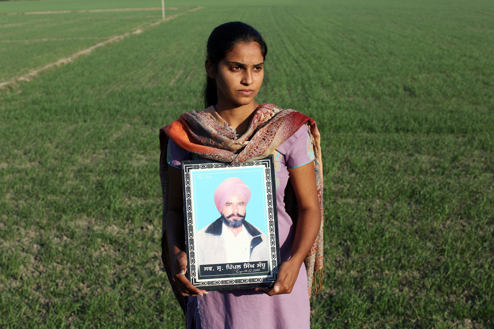 Sukhbeer Kaur (19) holds a portrait of her father, Pippal Singh, who died in 2010 of cancer, aged 40. It is believed that excessive pesticide use in the region over the past 30-40 years has led to the accumulation of dangerous levels of toxins such as uranium, lead and mercury which are contributing to increased health problems including cancers, birth defects and mental disabilities in children. It's a hidden epidemic which is gripping the Punjab region in northeast India which for decades has been the country's 'bread basket'.