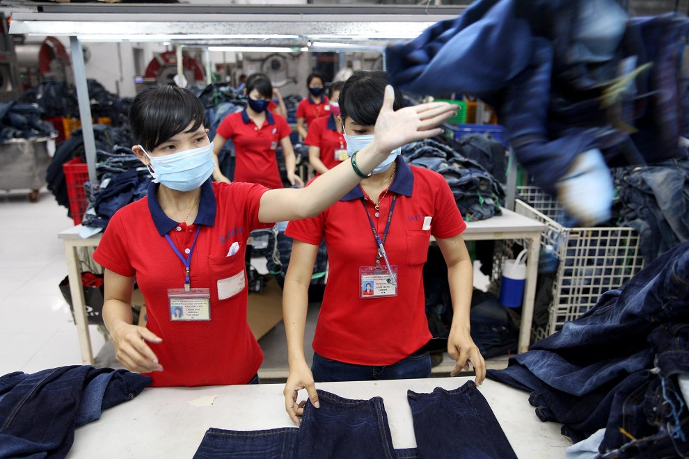 Workers sort through jeans at denim detailing company, Sai-Tex, located outside of Ho Chi Minh City.