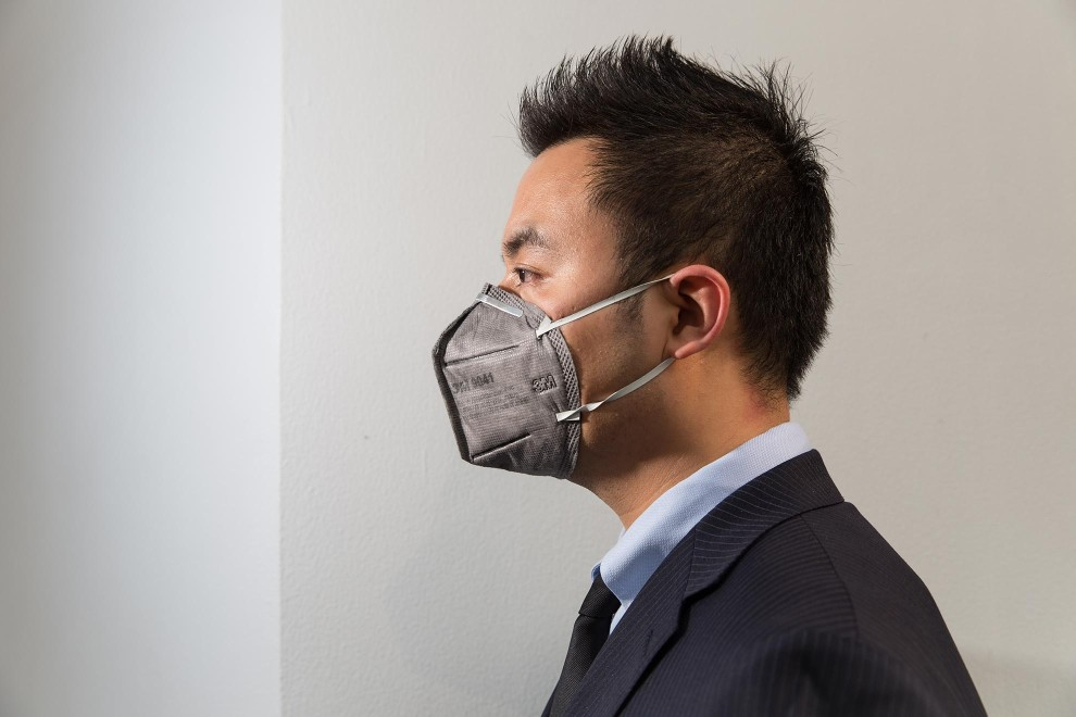 "Liu (33), a sharply-dressed office worker in central Beijing. ""I started to use the mask 3 years ago. Of course I am worried about the pollution. I bought them for everyone in my family and forced them to wear it."" PM2.5 reading - 170 - Unhealthy"