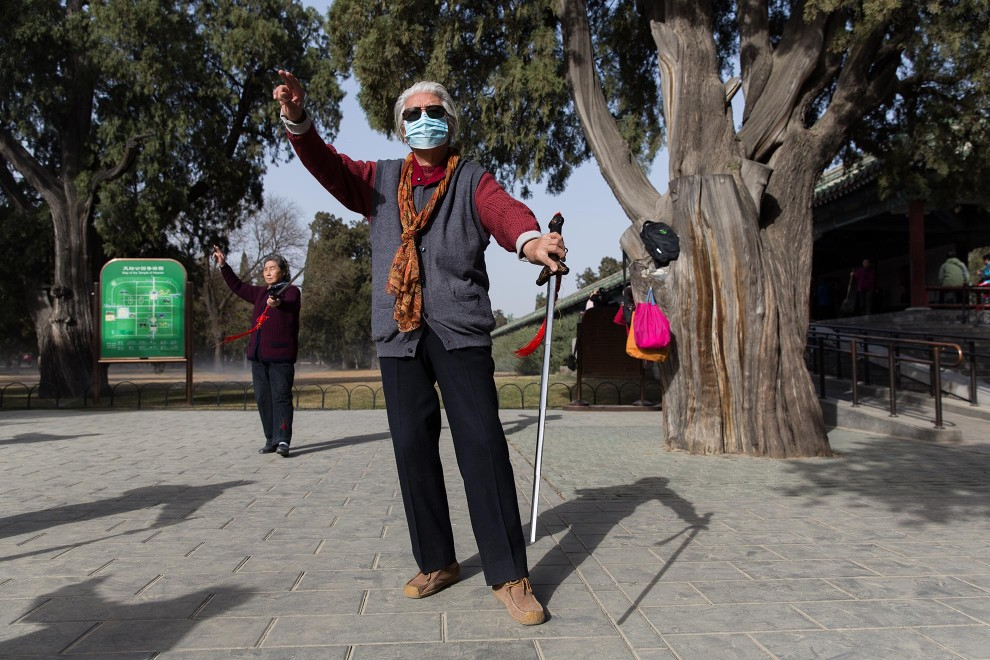 An elderly man performs to Tai Chi in Beijing's TianTan Park. The elderly and young are some of the most susceptible to the effects of air pollution, however this does not deter hundreds of the city's elderly residents who go to the parks everyday to socialise and exercise, no matter what the air quality. PM2.5 reading - 89 - Moderate