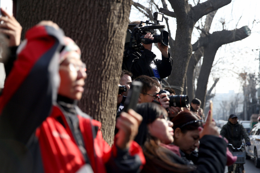 Media wait for HRH The Duke of Cambridge outside Shijia hutong in Beijing, where he met with charities supporting vulnerable young Chinese people.