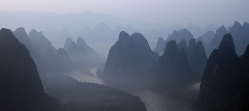 The Li River winds through Guilin's karst mountains shrouded in mist.