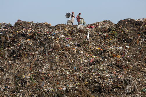 Workers collect and sort through garbage at the Dhapa landfill in the west of Kolkata.