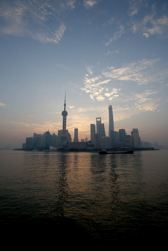 The distinctive Pudong skyline next to the Huangpu River just before sunrise.