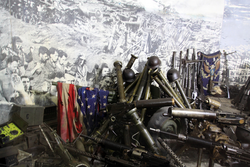 American weapons and flag on display in the The Victorious Fatherland Liberation War Museum.