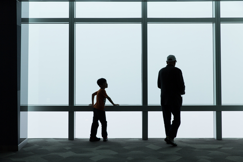 A man and child look out from the viewing platform of the Taipei 101 Tower.