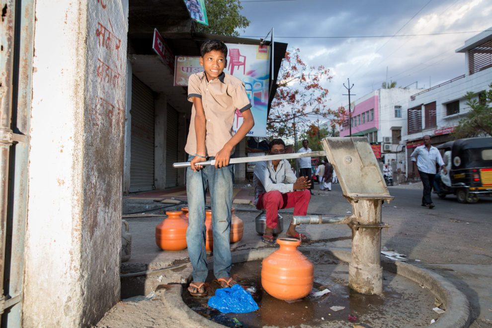 A boy tries desperately to squeeze water out of a pump on the streets of Latur, in western India. Many wells have run dry and the city's residents are largely reliant on water that is being transported by train from the west coast of the country.