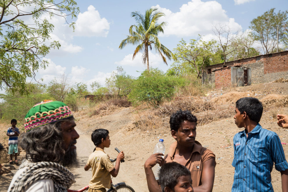 Villagers mill around in the farming community of Sayyad Ankulga, near Latur. As a result of the drought, many farmer's crops have failed and with no access to water nearby are forced to wait until the monsoon rains arrive in late June.