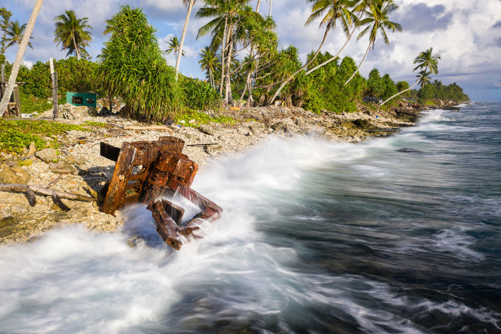 An earth mover lies abandoned and prone to the waves of the Pacific Ocean in Funafuti.
