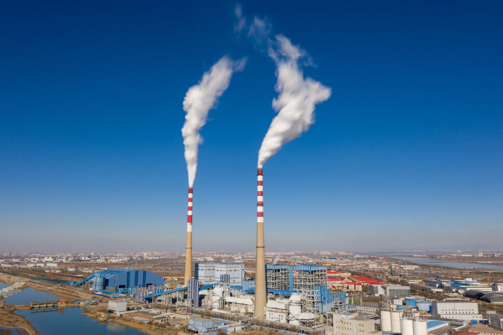 A factory releases emissions into the sky above the city of Tianjin, in north-east China.