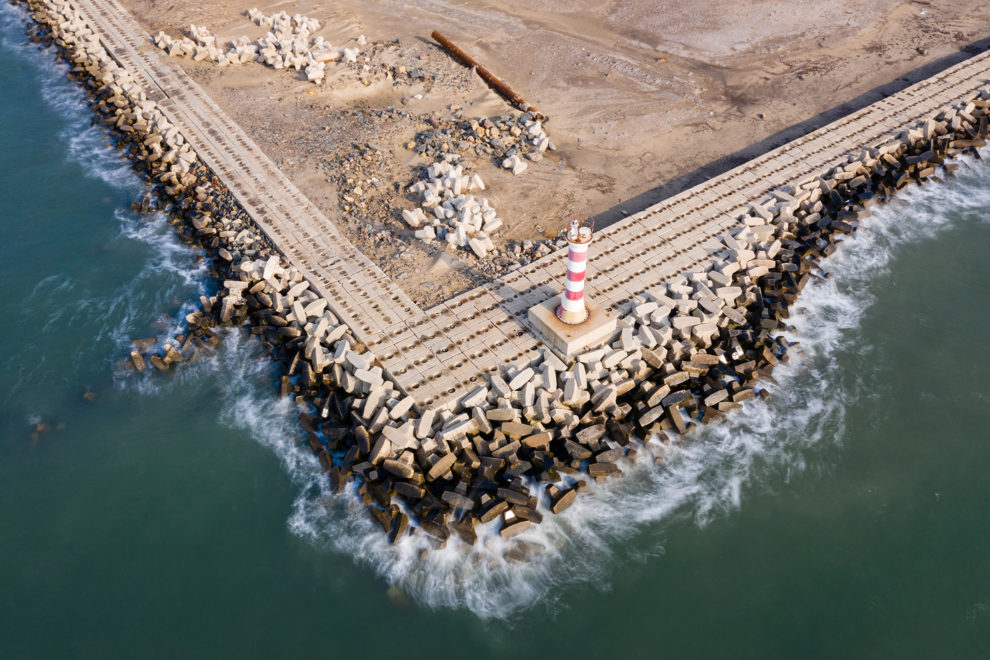Waves crash against sea wall defences in Jingtang harbour, Hebei province. China, 2019.