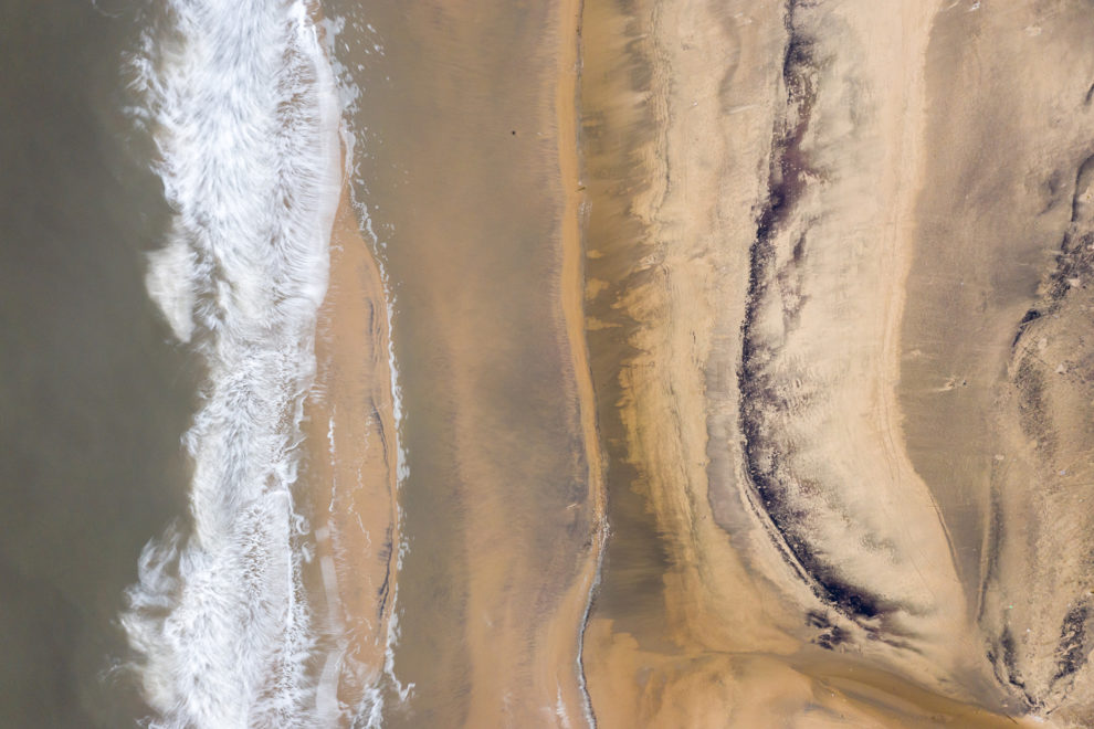 An oil-stained beach at Laomi Gukou in Hebei province. Bohai Bay is home to some of China's largest reserves of oil and gas, making it a centre for oil exploration. The region has suffered from a number of oil spills in recent decades which continue to effect local ecosystems. 2019