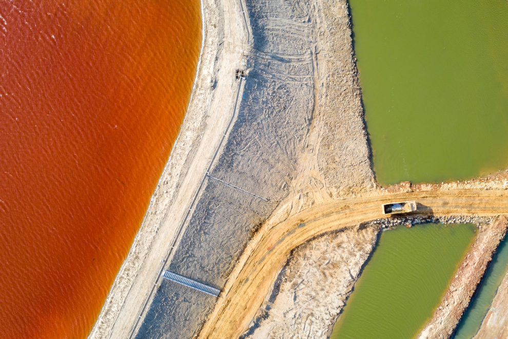 Unidentified industrial pollution is collected in a lake near the Pocheng River, which runs into Bohai Bay, in Shandong Province. China, 2019.