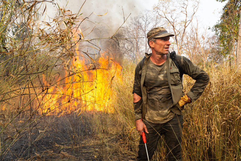 Cambodia-DeBen Davis, an American independent conservationist, battles a fire in the Phnom Tnout Phnom Pok Wildlife Sanctuary, in northern Cambodia. Fires are set by farmers, loggers and local people looking to either capture wildlife or clear land for agriculture.